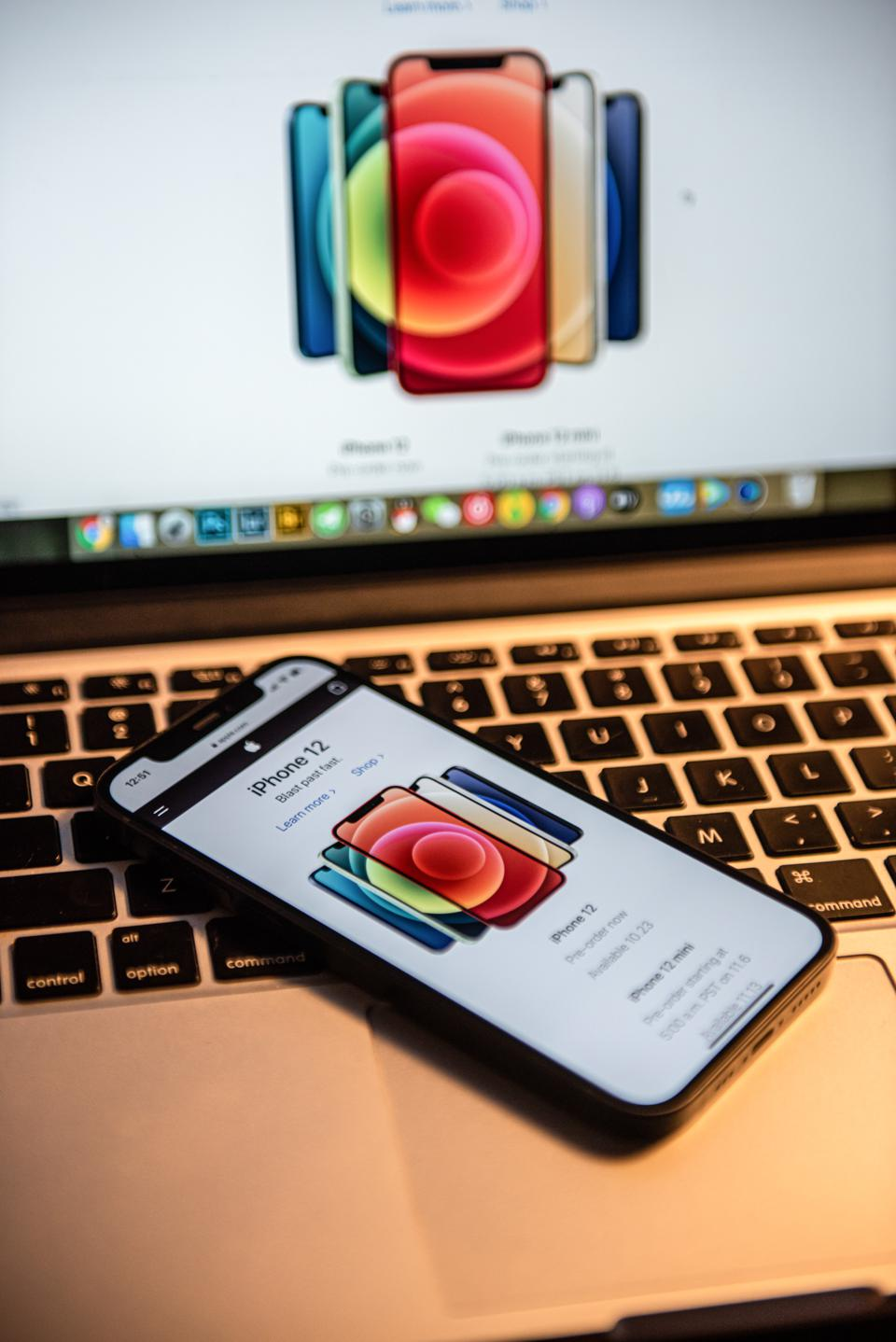 In this photo illustration an iPhone 12 smartphone is placed...