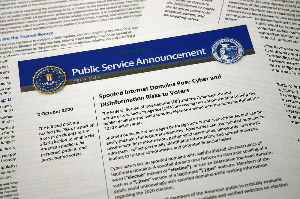 FILE - In this Oct. 6, 2020, file photo, a public service announcement from the FBI and the Department of Homeland Security cybersecurity agency. As President Donald Trump sows doubts about the election, an obscure government agency he created is working behind the scenes to inspire confidence in the vote amid unprecedented challenges. The Cybersecurity and Infrastructure Agency, which Trump signed into existence in 2018, is working with other parts of the government to safeguard an election in the middle of a pandemic. (AP Photo/Jon Elswick, File)