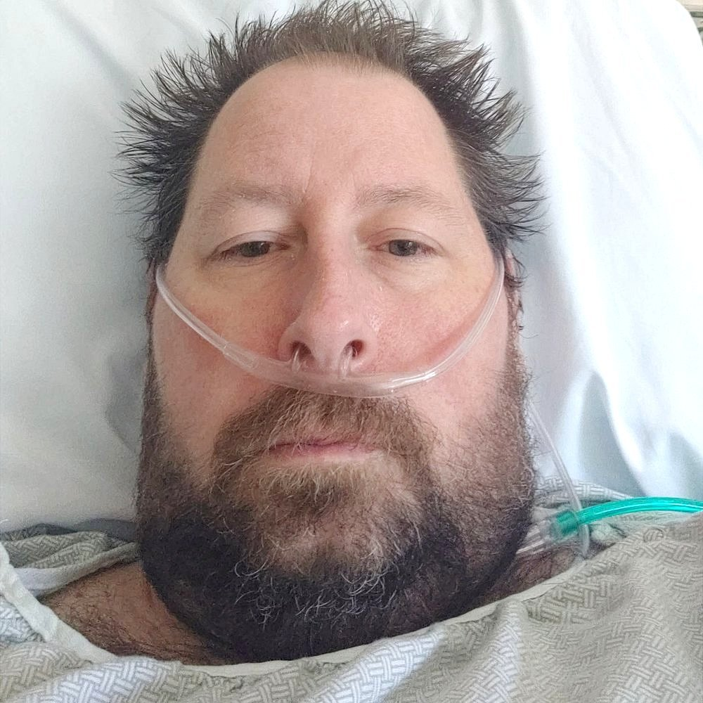 Brian lee Hitchens in a hospital bed
