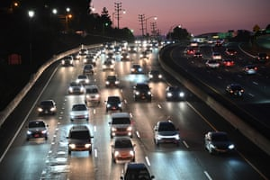 Vehicles drive on the 101 freeway in Los Angeles, California.