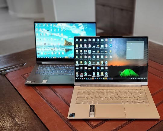 Lenovo's Yoga 9i in front and Yoga C940 in the back.
