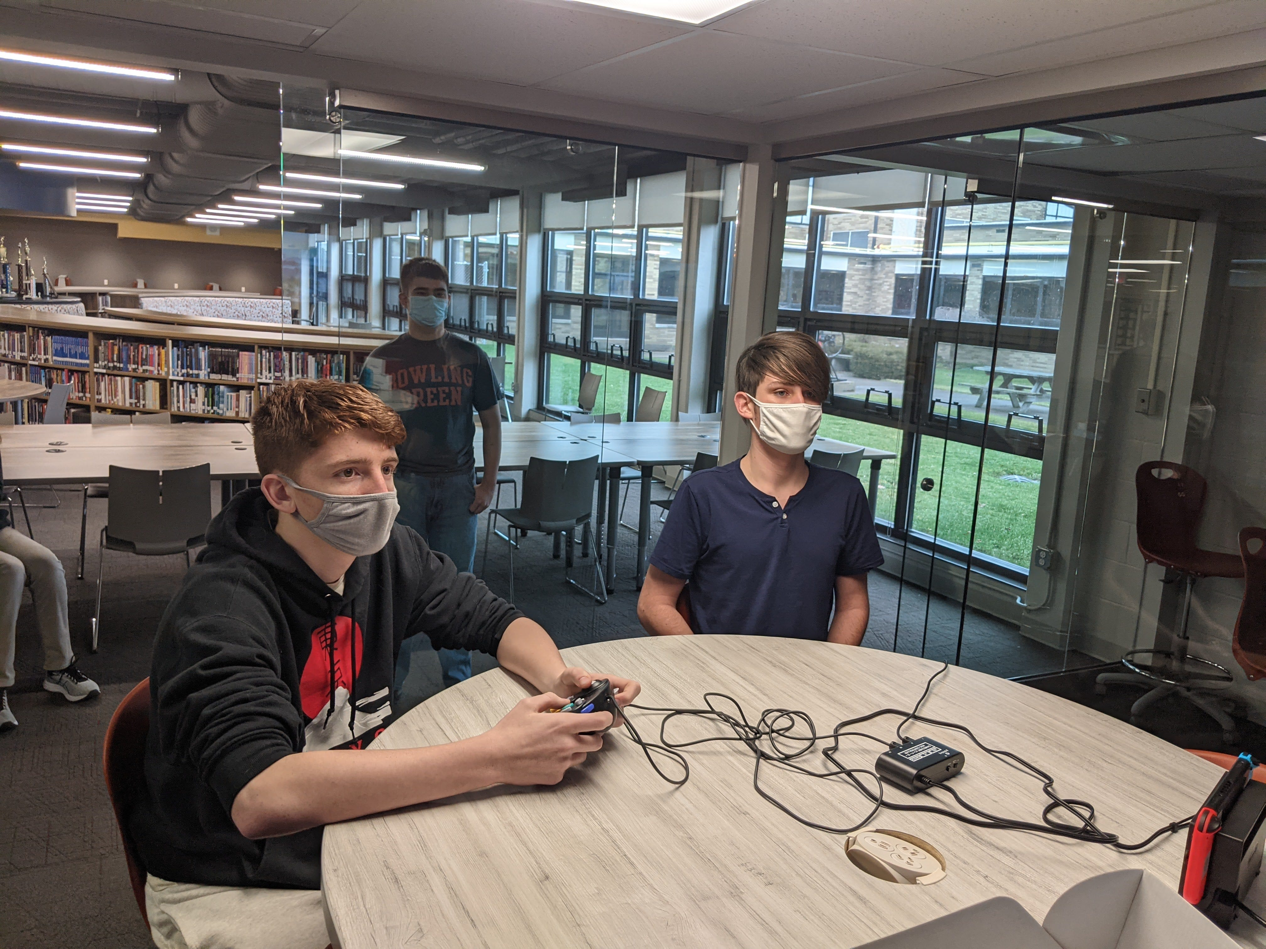 Port Clinton High School students Seth Haynes, Landon Staib, Captain, and Tyler Rodrigue-Hejhal participate in a practice session for the new esports club.